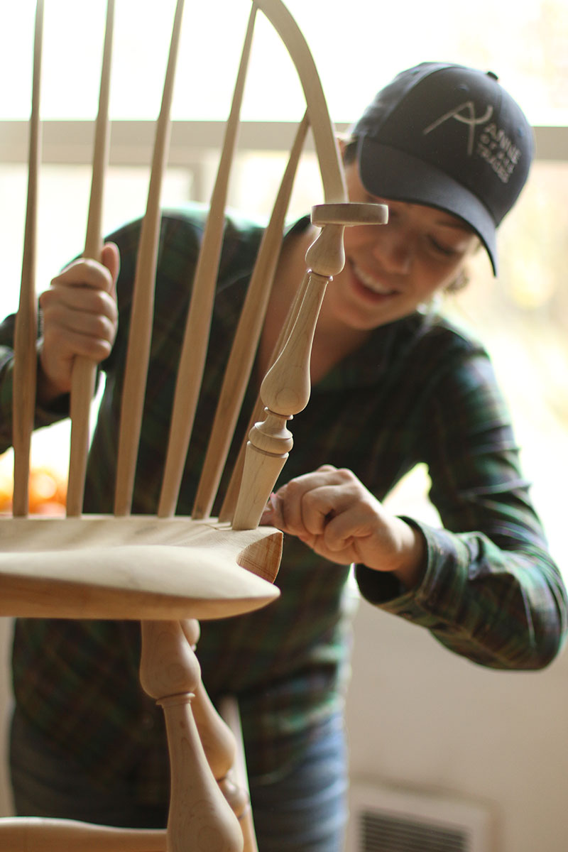 Anne of All Trades sanding wood chair