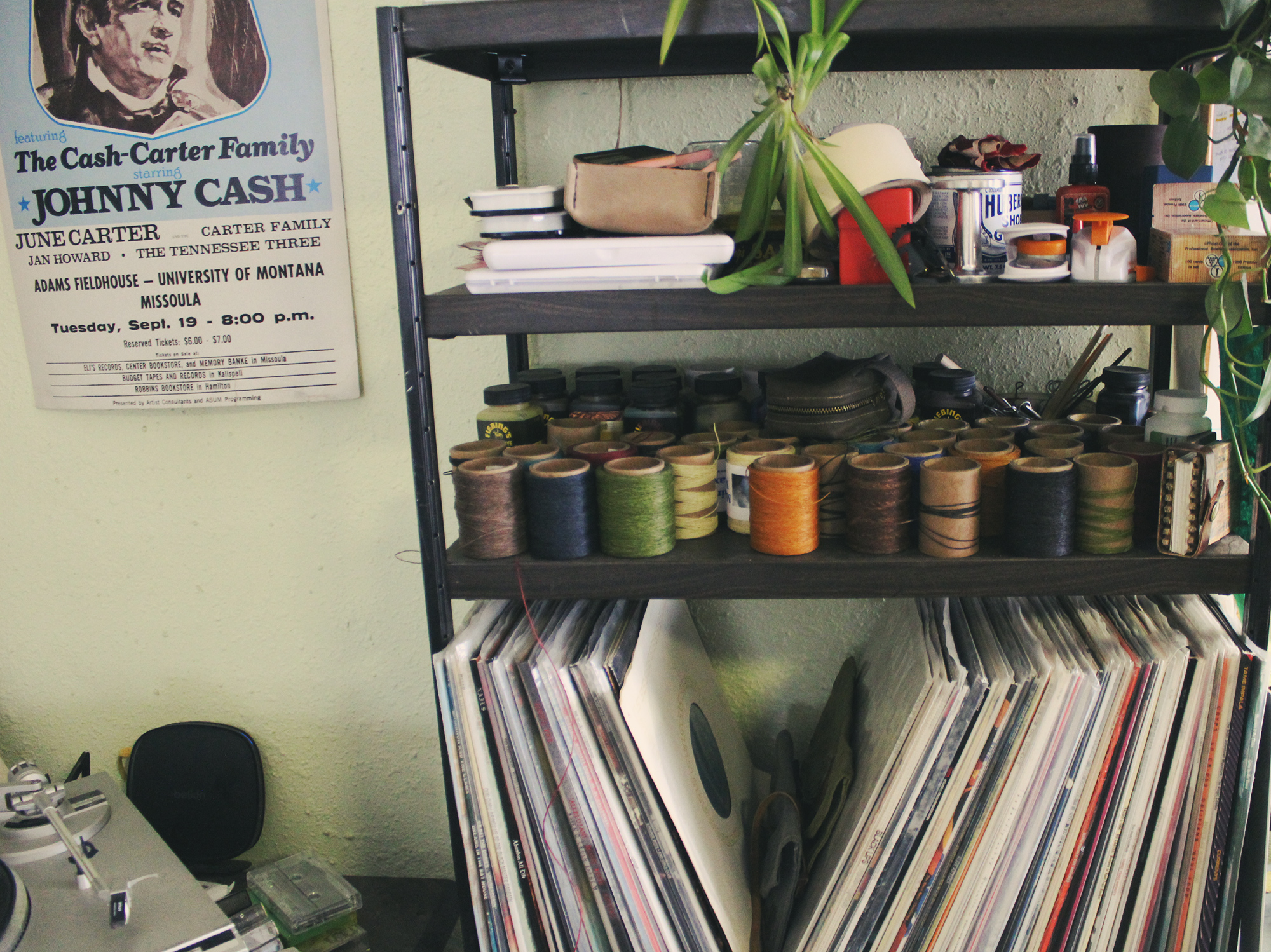 Vinyl records and waxed thread on a shelf
