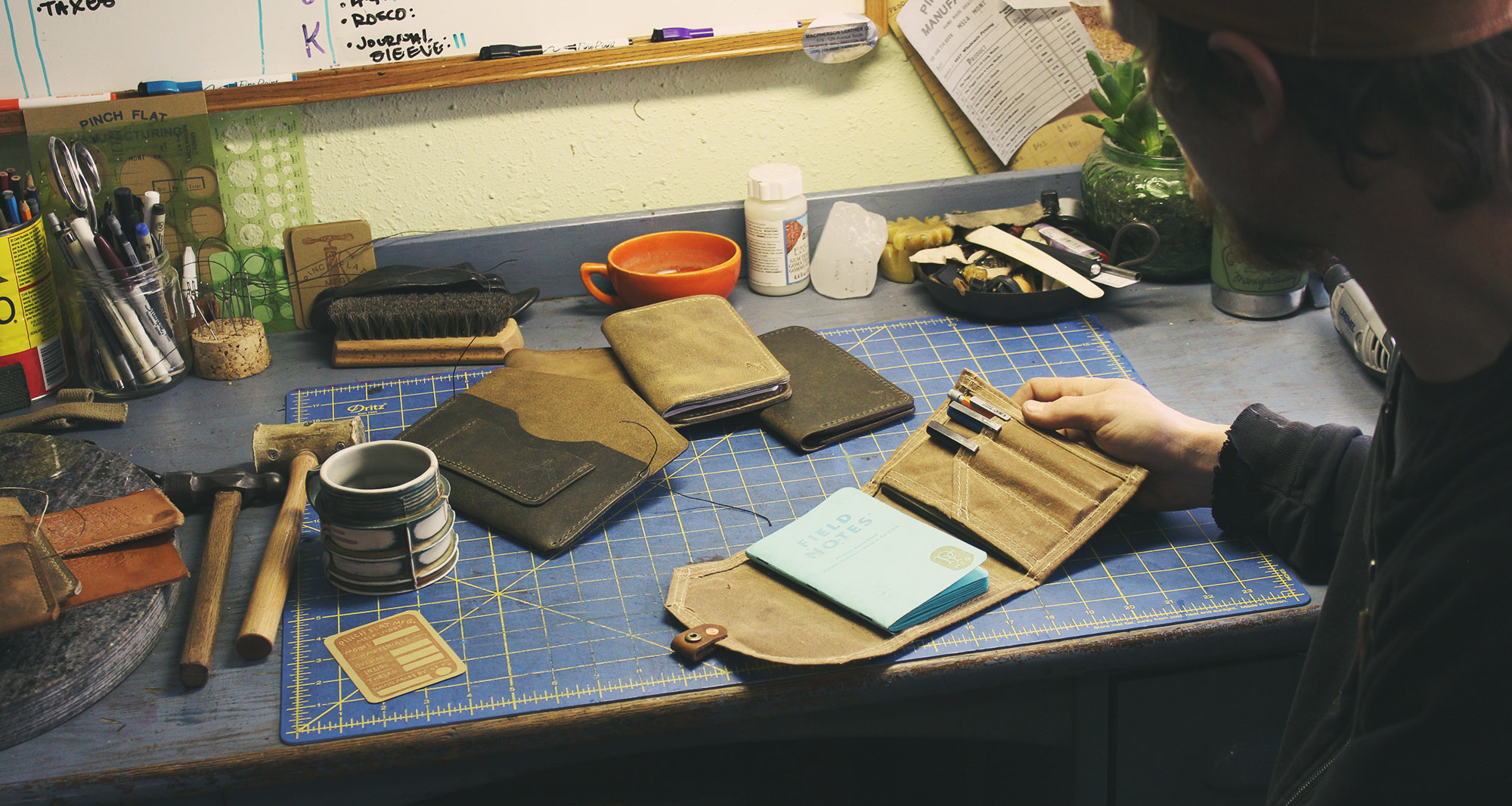 Leather and canvas worker Jeremy Haas at his workbench