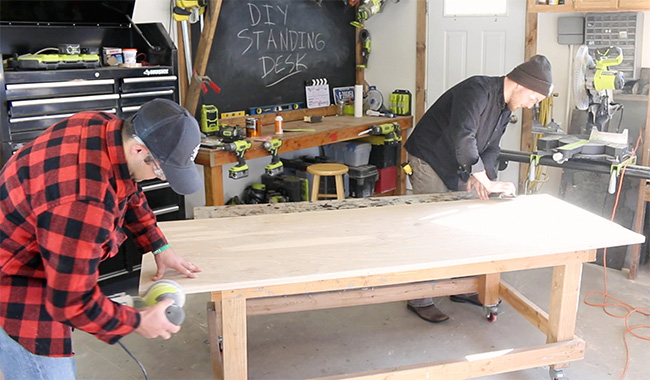 DIY Pete custom standing desk top sanding